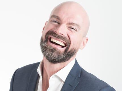 man smiling after dental implants treatment